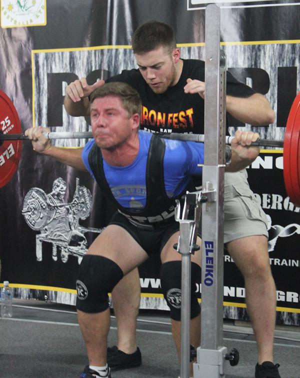 Phillip Grant squatting 217.5kg RAW at 82kg Bodyweight.